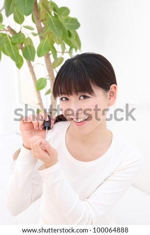Beautiful young asian woman manicure - stock photo