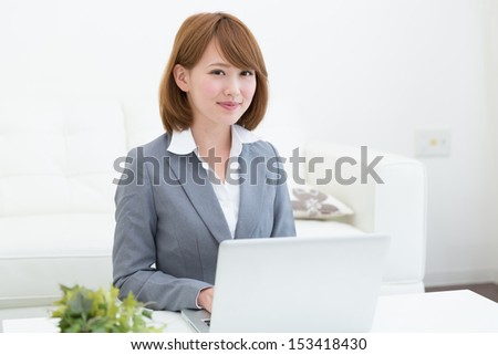 Beautiful young asian woman using laptop