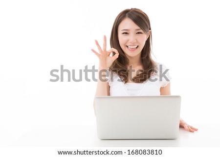 Beautiful young asian woman using laptop computer - stock photo