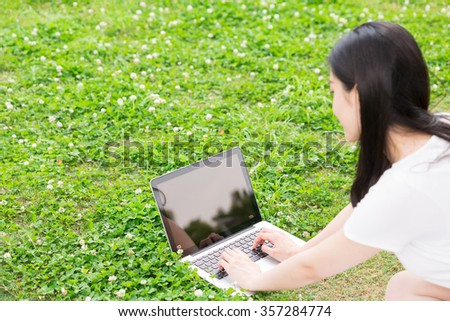 Beautiful young asian woman using laptop computer
