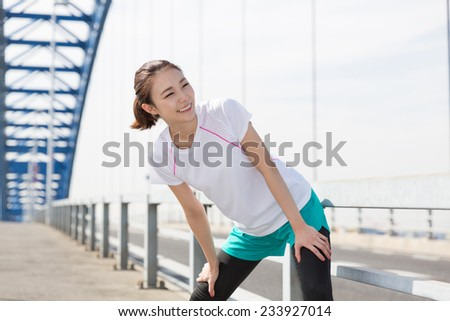 Beautiful young asian woman who exercises - stock photo