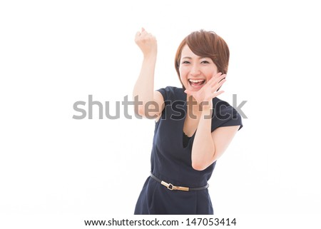 Beautiful young asian woman who is cheering - stock photo