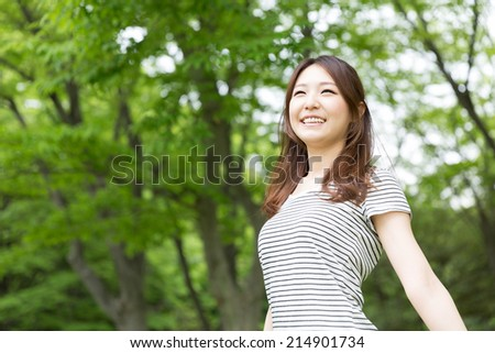 Beautiful young asian woman who smile - stock photo