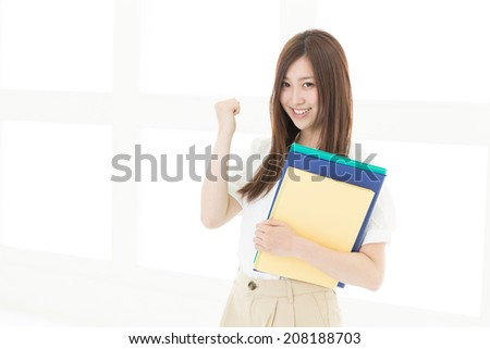 Beautiful young asian woman with a file