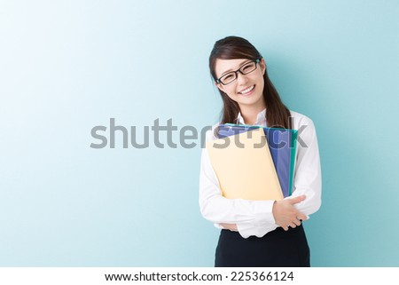 Beautiful young asian woman with a file - stock photo