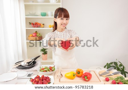 Beautiful young Asian woman with a heart - stock photo