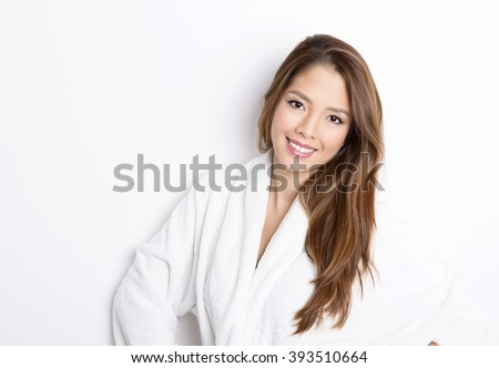 https://thumb1.shutterstock.com/display_pic_with_logo/122137/393510664/stock-photo-beautiful-young-asian-woman-with-flawless-skin-and-long-hair-posing-in-bath-robe-393510664.jpg