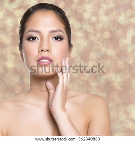 beautiful young asian woman with flawless skin and perfect make-up