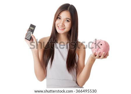 Beautiful young Asian woman with piggy bank and calculator  isolated on white background - stock photo