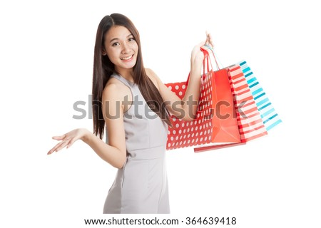 Beautiful young Asian woman with shopping bags  isolated on white background - stock photo