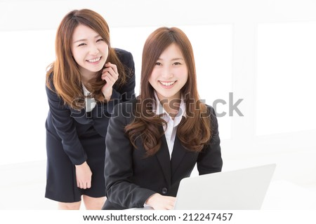 Beautiful young asian women using laptop