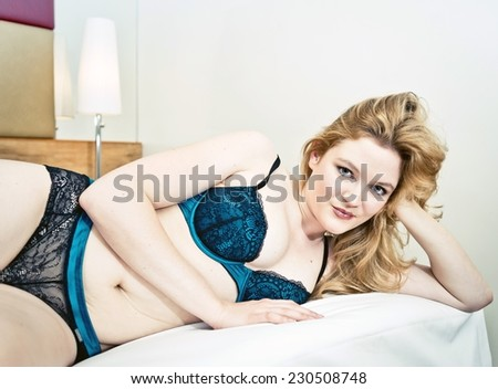 beautiful young attractive caucasian woman in blue lingerie  - stock photo