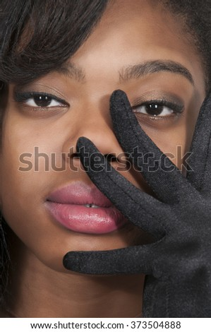 Beautiful young attractive high society woman wearing formal opera gloves - stock photo
