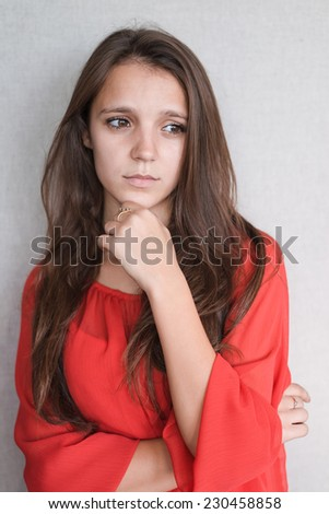 Beautiful young attractive woman  holding her chin - stock photo