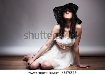 beautiful young attractive woman posing in a hat
