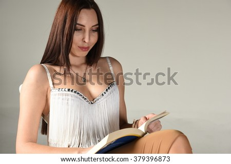 beautiful young attractive women reading book