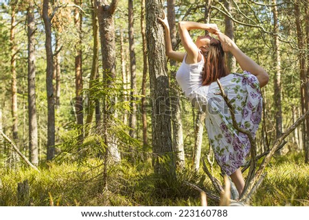 beautiful young ballet dancer girl in the forest in springtime