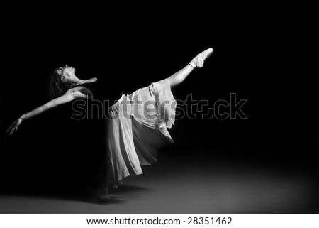 Beautiful young ballet dancer performing on stage.