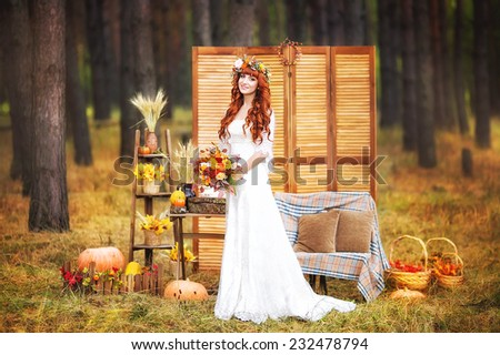 Beautiful young bide in a autumn park - stock photo