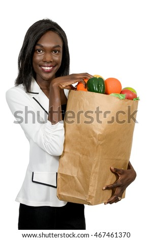 Beautiful young black African American woman with a brown paper shopping bag