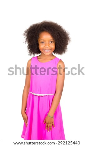Beautiful young black girl with afro and pink dress smiling to camera