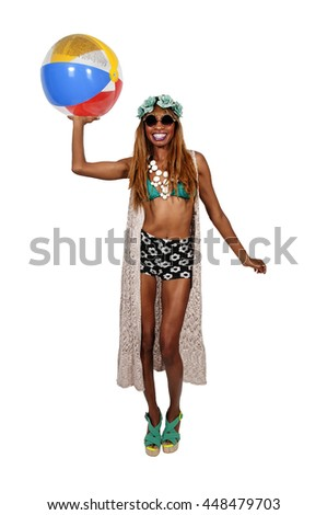 Beautiful young black woman holding a beach ball
