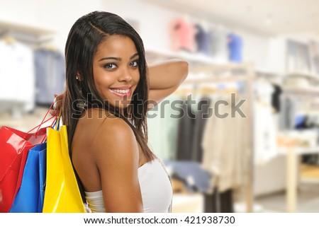 Beautiful young black woman shopping inside a mall - stock photo