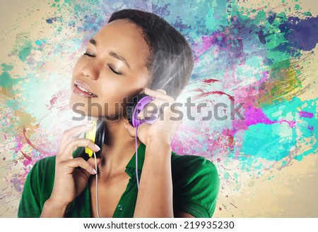 beautiful young black woman with headphones listen to the music - stock photo