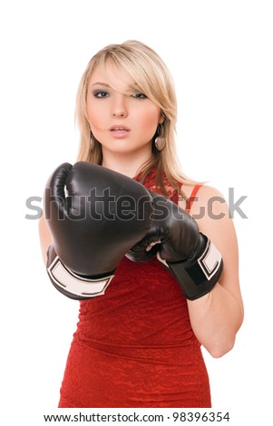 Beautiful young blond girl in boxing gloves