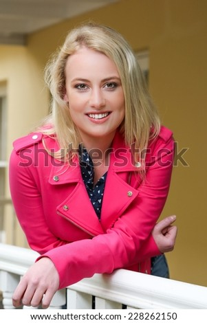 Beautiful young blond lady resting relaxing on the porch - stock photo