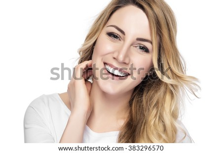 Beautiful young blond smiling woman with clean face. - stock photo