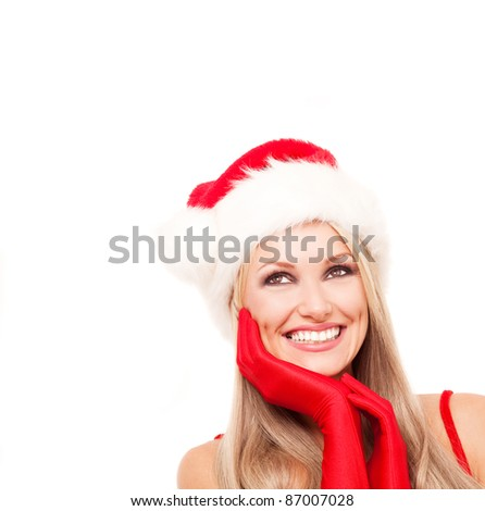 beautiful young blond woman dressed as Santa,looking up,  isolated against white background - stock photo
