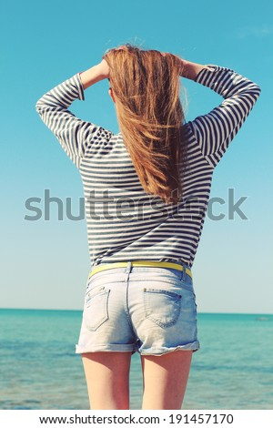 Beautiful young blond woman enjoying the beach on a sunny summer day.Photo toned style instagram filters - stock photo
