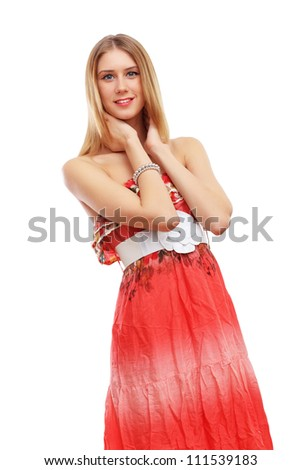 Beautiful young blond woman in red dress