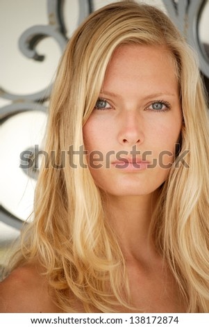 Beautiful young blond woman outdoor portrait. - stock photo