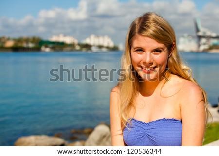 Beautiful young blond woman outdoors enjoying Miami Beach. - stock photo