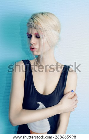 Beautiful young blond woman. Pink bright make-up. Princess style. Positive girl laughing. Lifestyle. Hipster. Ice-cream print.  - stock photo