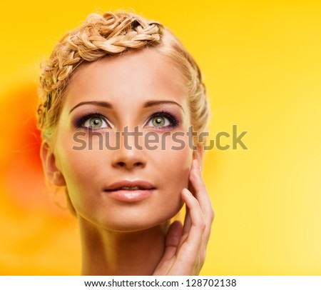 Beautiful young blond woman portrait - stock photo