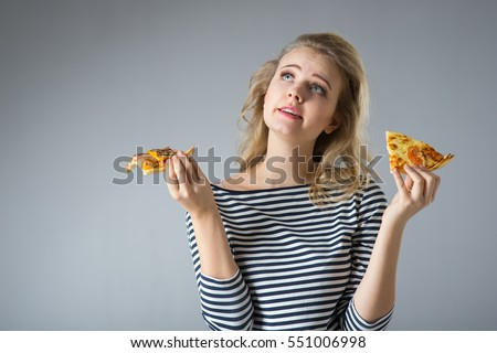 beautiful young blond woman refuses harmful food pizza on a gray background