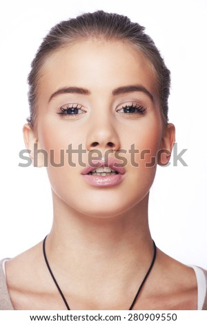 Beautiful young blond woman with ponytail and pink lips - stock photo