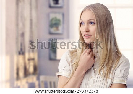 Beautiful young blonde casual blue eyed caucasian romantic woman daydreaming at retro home. Wondering, thinking. Copyspace. - stock photo