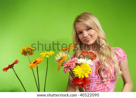 beautiful young blonde girl with a bouquet of flowers