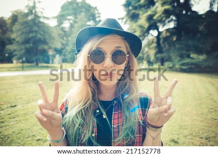 beautiful young blonde hair woman hipster in the city - stock photo