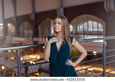 Beautiful young blonde in a building - stock photo