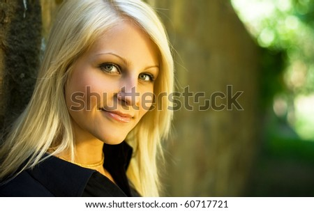 Beautiful young blonde teen posing for the camera. - stock photo
