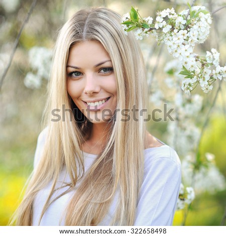 Beautiful young blonde woman face - close up  - stock photo