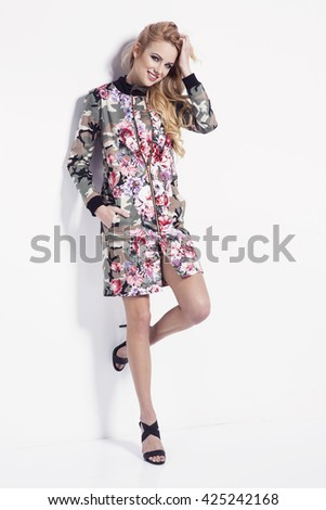beautiful young blonde woman in nice spring coat, high heels shoes posing in a studio. Fashion spring summer photo - stock photo