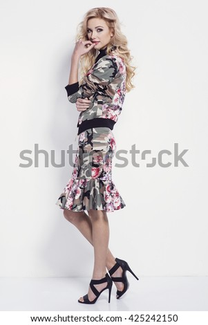 beautiful young blonde woman in nice spring dress, high heels shoes posing in a studio. Fashion spring summer photo - stock photo