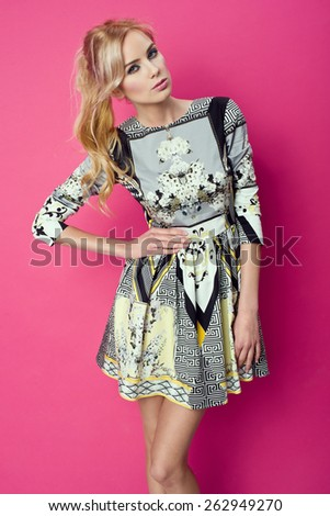 beautiful young blonde woman in nice spring dress, posing in studio. Fashion photo - stock photo