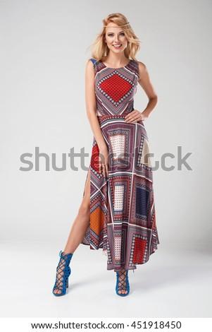 beautiful young blonde woman in nice summer boho dress, posing in a studio. Fashion spring summer photo - stock photo